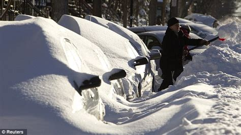 Cars in Montreal buried like snowy marshmallows as winter