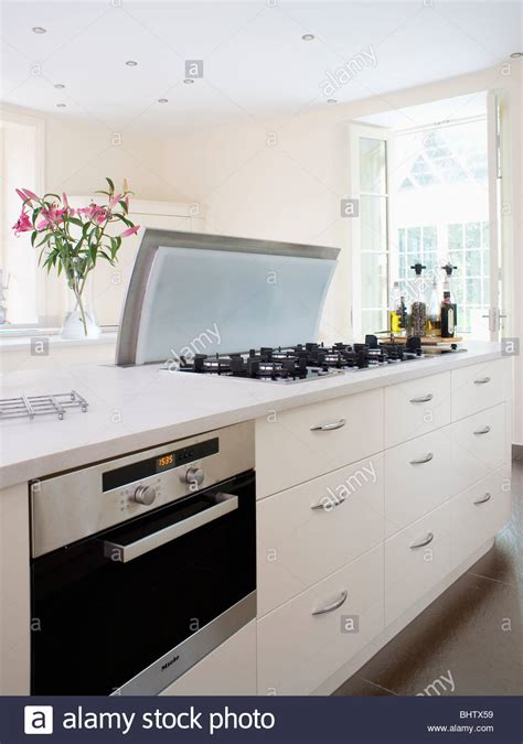 Fitted oven in white island unit with worktop-mounted